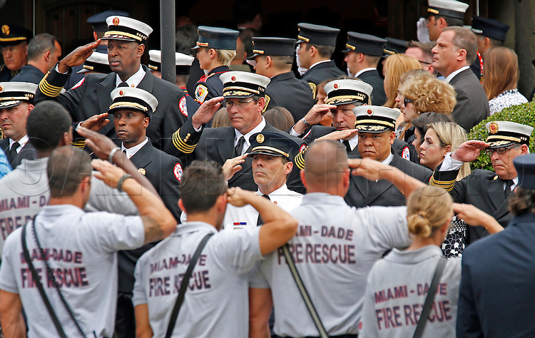 The funeral service at St. Kevin Roman Catholic Church for Rafael Garcia, 28, a popular City of Miami firefighter and paramedic, on Thursday, March 26, 2015. <br /> Garcia died Monday of a brain tumor<br /> His wife, Maeghan Garcia, is pregnant with a boy .