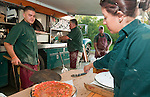 WATERTOWN, CT--051415JS18- Workers from the Big Green Pizza Truck, from left, Jay Tranberg; Chris Beauton; Wade Haskins and Caitlyn Nunes, made and served pizza during their appearance at during the Greater Waterbury Campership Fund&rsquo;s  fundraiser Thursday at the Waterbury YMCA&rsquo;s Camp Mataucha in Watertown.<br /> Jim Shannon Republican-American