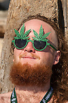 A Festival goer relaxes at Hempfest 2014 on the Seattle on August 17, 2014.  Seattle Hempfest, celebrating its 23rd anniversary, features six stages of music, world renowned speakers, hundreds of food, arts, crafts and political booths.   © Jim Bryant Photo. All rights reserved..