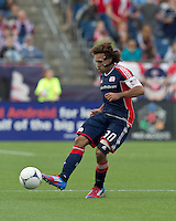 New England Revolution defender Kevin Alston (30) passes the ball. In a Major League Soccer (MLS) match, DC United defeated the New England Revolution, 2-1, at Gillette Stadium on April 14, 2012.