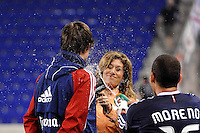 Alejandro Moreno (15) of CD Chivas USA squirts water on Justin Braun (17) as he is interviewed after the game. CD Chivas USA defeated the New York Red Bulls 3-2 during a Major League Soccer (MLS) match at Red Bull Arena in Harrison, NJ, on May 15, 2011.