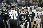 Officials separate Seattle Seahawks and New Orleans Saints  during the 2nd round in a NFL Western Division playoff game at CenturyLink Field in Seattle, Washington on January 11, 2014.  Seahawks beat the Saints 22-15 to take home-field advantage in the NFL Championship Game. ©2014. Jim Bryant Photo. ALL RIGHTS RESERVED.