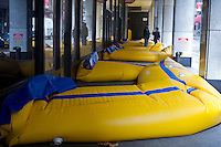 Inflatable barriers used to protect a building from flood damage seen in lower Manhattan in New York on Tuesday, October 30, 2012. Hurricane Sandy roared into New York disrupting the transit system and causing widespread power outages. Con Edison is estimating it will take four days to get electricity back to Lower Manhattan.  (© Frances M. Roberts)