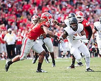 The Georgia Bulldogs beat the App State Mountaineers 45-6 in their homecoming game.  After a close first half, UGA scored 31 unanswered points in the second half.  Appalachian State Mountaineers wide receiver Andrew Peacock (11), Georgia Bulldogs linebacker Ramik Wilson (51)