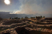 Ruins of the Great House Pueblo and kiva at the Chaco Pueblo site at Chimney Rock National Monument, in Chimney Rock State Park, in San Juan National Forest, South West Colorado, USA, and smoke from a wildfire. The ridge was an ancestral Puebloan site occupied 925-1125 AD by around 2000 Indians. Chimney Rock was made a National Monument in 2012 and is listed on the US National Register of Historic Places and the Colorado State Register of Historic Properties. Picture by Manuel Cohen