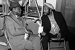 Bukka White and Brownie McGhee, January 17, 1975, Berkeley Blues Festival. Two pioneers of the blues. Delta blues guitarist and singer. Born Booker T. Washington (Bukka) White between Aberdeen and Houston, Mississippi, he gave his cousin B.B. King, a Stella guitar, King's first guitar. White himself is remembered as a player of National steel guitars.<br /> <br /> McGhee, a blues singer and guitarist,is best known for his collaborations with the harmonica player Sonny Terry. During the blues revival of the 1960s, Terry and McGhee were very popular on the concert and music festival circuits, occasionally adding new material but usually remaining faithful to their roots and their audience.
