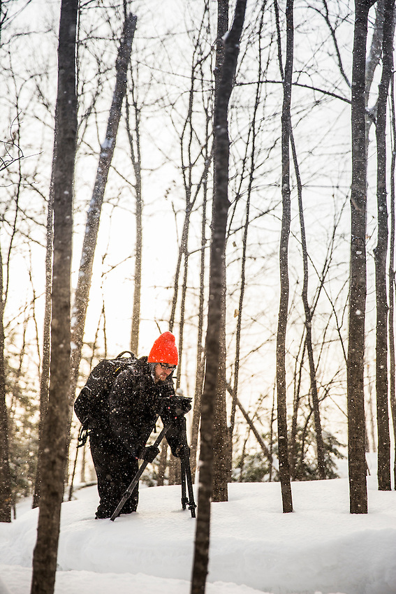 Photographer and filmmaker Aaron Peterson while working in winter.