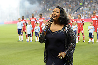 The National Anthem performed by Ida McBeth...Sporting KC were held to a scoreless tie with Chicago Fire in the inauguarl game at LIVESTRONG Sporting Park, Kansas City, Kansas.