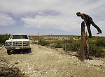 A U.S. Border Patrol agent in Del Rio, Texas climbs a fence while tracks a set shoe prints he found on a grated roadway.  While the traditional mission of the United States Border Patrol has always been the detection and prevention of the illegal entry of aliens and smuggling of illegal contraband into the United States anywhere other than a designated port-of-entry, the dawn of the age of terrorism within our nation has added a new and high priority mission: to detect and prevent the entry of terrorists and their weapons into the United States. Jim Bryant Photo..©2006. All Rights Reserved.