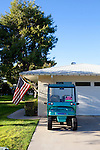 A golf cart advertised for sale sits in a driveway in Sun City, Arizona. Golf carts, a common mode of transportation in Sun City, Arizona December 11, 2010. Many of the busy roads in Sun City offer a golf cart lane...2010 marks the 50th anniversary of Sun City, America's first retirement city that remains the largest today with more than 40,000 residents 55 and older.