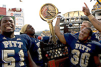 Pitt football players display the River City Rivalry Trophy after the Pitt Panthers defeated the Cincinnati Bearcats 24-17 on October 20, 2007 at Heinz Field, Pittsburgh, Pennsylvania.