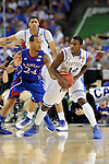 2 APR 2012: Guard Travis Releford (24) from the University of Kansas tries to steal the ball from forward Michael Kidd-Gilchrist (14) from the University of Kentucky during the Championship Game of the 2012 NCAA Men's Division I Basketball Championship Final Four held at the Mercedes-Benz Superdome hosted by Tulane University in New Orleans, LA. Kentucky defeated Kansas 67-59 to claim the championship title. Ryan McKeee/ NCAA Photos.