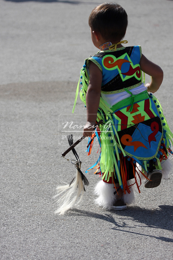 A young Native American Indian boy dancing in a fancy outfit at a Pow Wow at the Milwaukee Lakefront Indian Summer Festival, Wisconsin