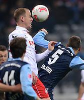 Fussball 2. Bundesliga:  Saison   2012/2013,    14. Spieltag  TSV 1860 Muenchen - 1. FC Koeln  16.11.2012 Kevin Mc Kenna (li, 1. FC Koeln) gegen Guillermo Vallori (1860 Muenchen)