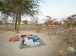 Newly arrived people sleep under a tree in an internally displaced persons camp in Manangui, South Sudan. Families started arriving here shortly after fighting broke out in December 2013, and new arrivals continued to appear three months later as fighting drug on. Many are living in the open and under trees. The ACT Alliance is providing the displaced families and the host communities affected by their presence with a variety of support.