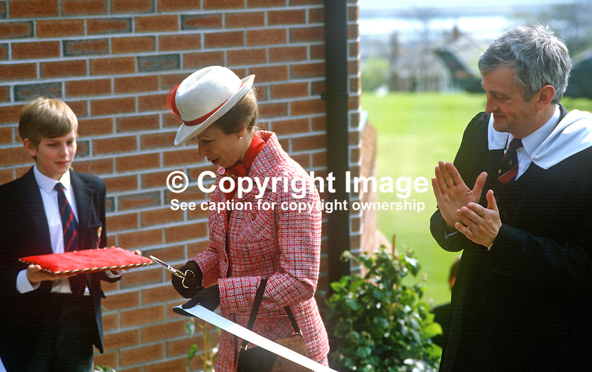 Princess Anne on a May 1985 visit to N Ireland is pictured cutting the tape at the official opening of an extension to Belfast Royal Academy's Preparatory Department at its Ben Madigan campus. The pupil who presented her with the scissors is 11 year old Richard Moore. Right in the phone in the photo is Bill Sillery, principal, 19850501j..Copyright Image from Victor Patterson, 54 Dorchester Park, Belfast, UK, BT9 6RJ..Tel: +44 28 9066 1296.Mob: +44 7802 353836.Voicemail +44 20 8816 7153.Skype: victorpattersonbelfast.Email: victorpatterson@me.com.Email: victorpatterson@ireland.com (back-up)..IMPORTANT: If you wish to use this image or any other of my images please go to www.victorpatterson.com and click on the Terms & Conditions. Then contact me by email or phone with the reference number(s) of the image(s) concerned.