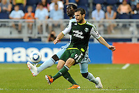 Mike Chabala (4) defender Portland Timbers challenged by C.J Sapong (17) forward Sporting KC... Sporting Kansas City defeated Portland Timbers 3-1 at LIVESTRONG Sporting Park, Kansas City, Kansas.