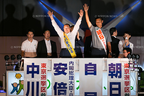 (L to R) Liberal Democratic Party candidates Masaharu Nakagawa and Kentaro Asahi, greet supporters during a campaign event in Akihabara on July 9, 2016, Tokyo, Japan. Shinzo Abe, leader of the Liberal Democratic Party and Prime Minister of Japan delivered his last campaign speech before the July 10th House of Councillors elections. (Photo by Rodrigo Reyes Marin/AFLO)