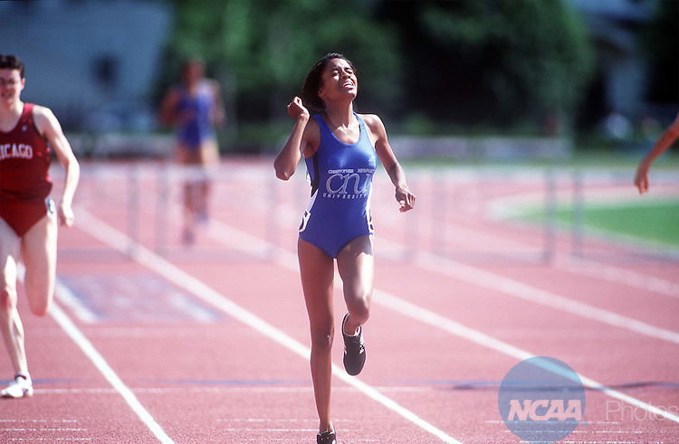May 23 1998:  AChristoper Newport University runner pushes to take the lead during a race final in the NCAA Division III outdoor track and field championships were held at the Macalester Stadium at Macalester College in St. Paul, Minnisota.  Bruce Kluckhorn/ NCAA Photo