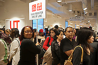 End of the line for the check-out at the grand opening of the Uniqlo Flagship store on Fifth Avenue in New York on Friday, October 14, 2011.  The store is a staggering 89,000 square feet on multiple levels and is Fast Retailing's second store in the United States with a third opening next week in the Herald Square shopping district. The largest store on Fifth Avenue filled to the brim with affordable clothing it competes with stalwarts such as the Gap and Zara which are in the immediate proximity. Fast Retailing plans on opening 200 to 300 stores worldwide until 2020 and currently has 1000 stores. (© Richard B. Levine)