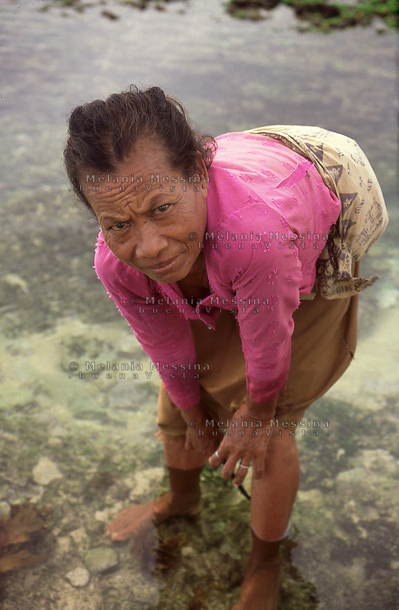 Indonesia, Java Island: harvester of seaweed.<br />