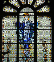 Stained glass window of the Virgin Mary, 1974, by Michel Durand, in 3 lancet format, in the centre of the choir of Le Havre Cathedral, or Cathedrale Notre-Dame du Havre, built in the 16th and 17th centuries and made cathedral in 1974, on the Rue de Paris in Le Havre, Normandy, France. This is one of the few buildings in the town to survive the bombings during the Second World War, although it did sustain heavy damage. Only 2 of the original stained glass windows survived. The centre of Le Havre is listed as a UNESCO World Heritage Site. Picture by Manuel Cohen.