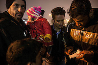 February 17, 2016: A family of migrants from Herat, Afghanistan gather at the metro staiton in Aksaray, a neighbourhood located in the Fatih district of Istanbul. The area has turned into one of the main destinations along the smuggling route for the refugees and migrants on their way to Europe