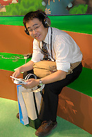A game show visitor playing a Nintendo DS.