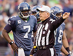 Referee Ron Winter, signals a call against the San Francisco 49ers as Seattle Seahawks quarterback Tarvaris Jackson watches  at  .CenturyLink Field in Seattle, Washington on December 24, 2011.  The 49ers came from behind to beat the Seahawks 19-17. ©2011 Jim Bryant Photo. All Rights Reserved.