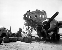 Wreckage of big transport which North Koreans hit while it was on Kimpo Airfield, is again in friendly hands, upon recapture of field.  September 18, 1950.  Sgt. Frank C. Kerr. (Marine Corps)<br /> NARA FILE #:  127-N-A2812<br /> WAR &amp; CONFLICT BOOK #:  1500