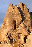 Homes carved from tufa formations or Peri Bacalari, Cappadocia, Turkey