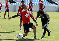 Chris Kolb#22 with Ben Olsen head coach of D.C. United during a training session in Hapgood Stadium on the campus of the Citadel,on March 11 2011, in Charleston, South Carolina