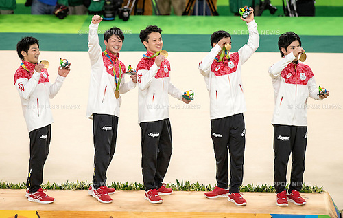 (L-R) Koji Yamamuro, Kohei Uchimura, Yusuke Tanaka, Kenzo Shirai, Ryohei Kato (JPN),<br /> AUGUST 8, 2016 - Artistic Gymnastics :<br /> Koji Yamamuro, Kohei Uchimura, Yusuke Tanaka, Kenzo Shirai and Ryohei Kato of Japan celebrate on the podium with their gold medals during the Men's Team Medal Ceremony at Rio Olympic Arena during the Rio 2016 Olympic Games in Rio de Janeiro, Brazil. (Photo by Enrico Calderoni/AFLO SPORT)