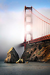 The Golden Gate bridge shrouded in mist at sunrise