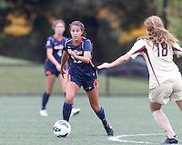 Pepperdine University forward Callie Payetta (11) works to clear ball. Pepperdine University defeated Boston College,1-0, at Soldiers Field Soccer Stadium, on September 29, 2012.