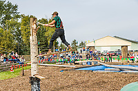 Lumberjack compete in log chopping contest at the Alaska State Fair, Palmer, Alaska.