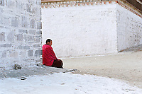 A monk of the Gelupka order is waiting for the beginning of the first ceremony of the New Year, in the monastery of Labrang, during Monlam Chenmo ( the Great Prayer). Xiahe, China, February 22, 2007. High Resolution available
