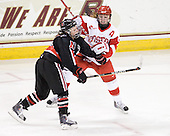 Maggie DiMasi (NU - 4), Lauren Cherewyk (BU - 7) - The Northeastern University Huskies tied Boston University Terriers 3-3 in the 2011 Beanpot consolation game on Tuesday, February 15, 2011, at Conte Forum in Chestnut Hill, Massachusetts.