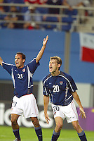 Landon Donovan and Brian McBride protest a referee's call. The USA lost 3-1 against Poland in the FIFA World Cup 2002 in Korea on June 14, 2002.