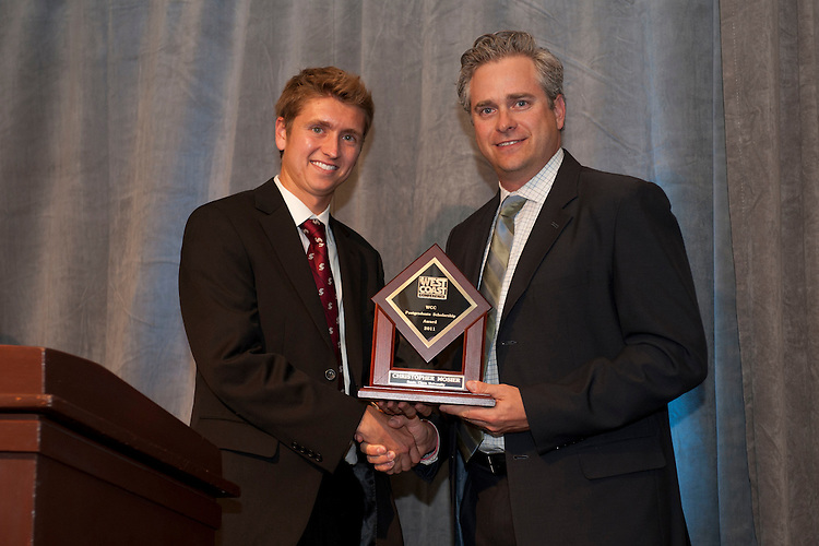 June 2, 2011; San Francisco, CA, USA; Santa Clara Broncos cross country runner Christopher Mosier (left) receives the Postgraduate Scholarship award from WCC commissioner Jamie Zaninovich (right) during the WCC Honors Dinner at the Westin St. Francis Hotel.