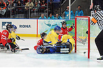Team Canada players crash the net for this goal during 2010 Paralympic Games sledge hockey action at UBC Thunderbird Arena in Vancouver. Credit: CPC/HC/Matthew Manor.