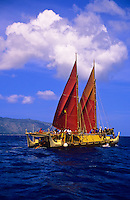 Polynesian voyaging canoe Hokule'a sailing past Kaena Point after leaving Haleiwa harbor on Oahu's North Shore. Hokule'a travels to many Pacific islands and is often used to teach school children about environmental concerns, sustainability and non-