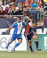 Philadelphia Union midfielder Daniel Cruz (44) dribbles. New England Revolution defender Flo Lechner (2) defends. In a Major League Soccer (MLS) match, the New England Revolution tied Philadelphia Union, 0-0, at Gillette Stadium on September 1, 2012.