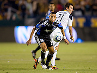 LA Galaxy forward Alan Gordon (21) and San Jose Earthquake defender Jason Hernandez (21) battle for a loose ball. The LA Galaxy and the San Jose Earthquakes played to a 2-2 draw at Home Depot Center stadium in Carson, California on Thursday July 22, 2010.