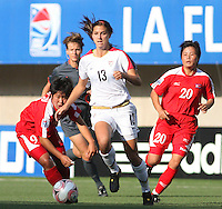 Santiago, Chile: Americar's player Alex Morgan (C) dispute the ball with Korea DRPs player Choe (L) Un Ju during the finals match in the Fifa U-20 Women´s World Cup at Florida´s Municipal Stadium, on December 07 th, 2008. By Grosnia / ISIphotos.com