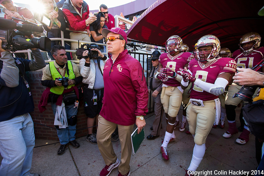 TALLAHASSEE, FL 11/29/14 FSU-UF112914-Florida State Head Coach Jimbo Fisher leads his team out of the tunnel before the University of Florida game Saturday at Doak Campbell Stadium in Tallahassee. <br /> COLIN HACKLEY PHOTO