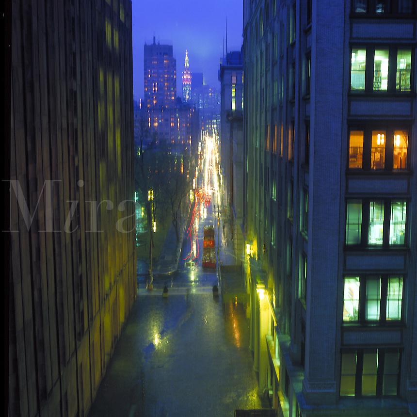 Rain streaked twilight view of Fifth Avenue in Manhattan. New York, New York.