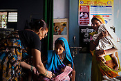 The Auxiliary Nurse Midwife, Asha Tripathi administers young children at the Anganwadi centre in Kalesra Kala village in Lalitpur district of Uttar Pradesh, India. The Indian government spends $1.4 billion a year - on programs that include weighing newborn babies, counseling mothers on healthy eating and supplementing meals, but none of this is yeilding results. According to UNICEF, some 48% of Indian children, or 61 million kids, remain malnourished, the clinical condition of being so undernourished that their physical and mental growth are stunted. Photo: Sanjit Das/Panos for The Wall Street Journal.Slug: IMALNUT