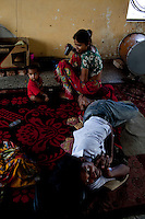 A family living in the 3 storey abandoned building that has been made into the Motiakhan Shelter for homeless people, in Paharganj on 5th October 2010, in Old Delhi, India. Picture: Suzanne Lee for The Australian.