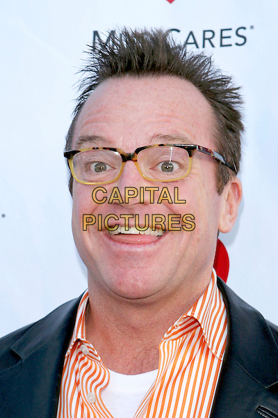 TOM ARNOLD.Attends The Musicares Map Fund Concert to Honor Goldenvoice held at The Henry Fonda Music Box Theatre in Hollywood, California, USA, May 20th 2005..portrait heashot funny face orange striped shirt glasses.Ref: ADM.www.capitalpictures.com.sales@capitalpictures.com.©JWong/AdMedia/Capital Pictures.